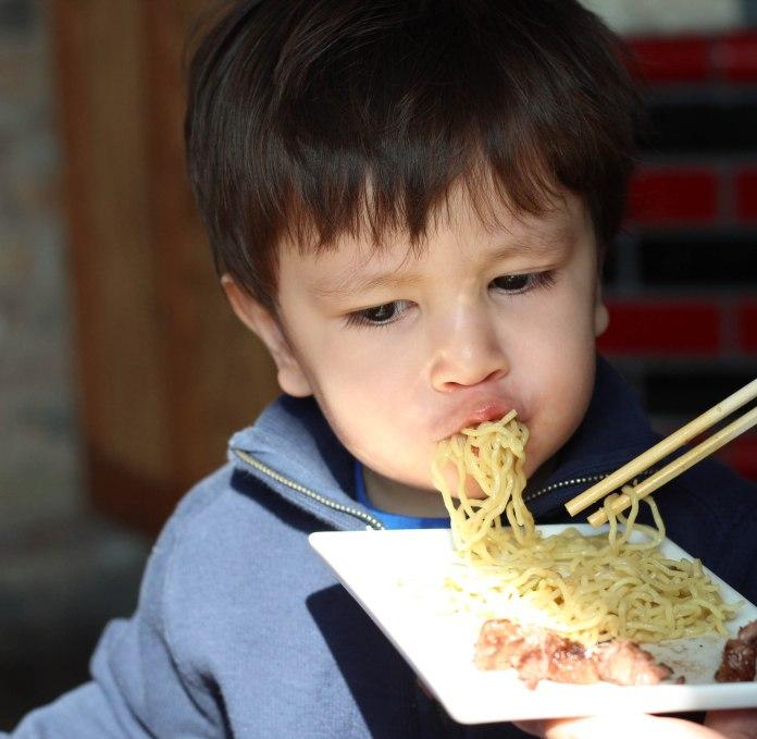 Luke devouring ramen noodles