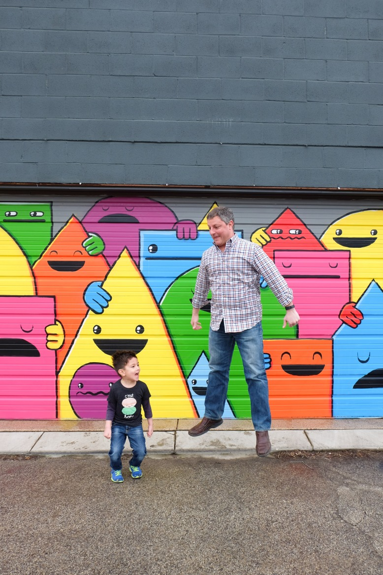 let s explore a colorful garage mural second city mom this mural is on a residential garage which i think it pretty cool i love how bright and colorful it is and how all the shapes are smiling